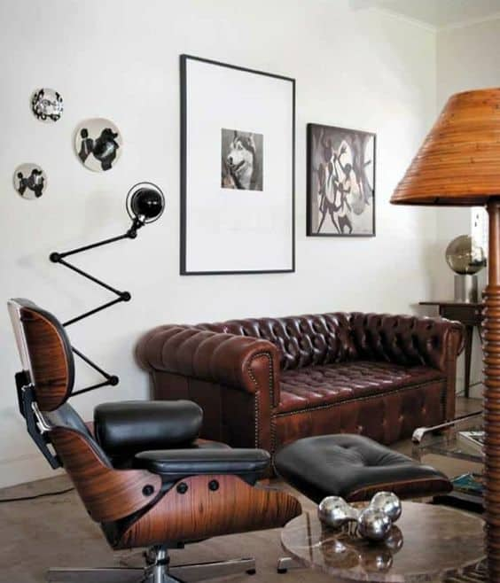A living room filled with leather furniture and art