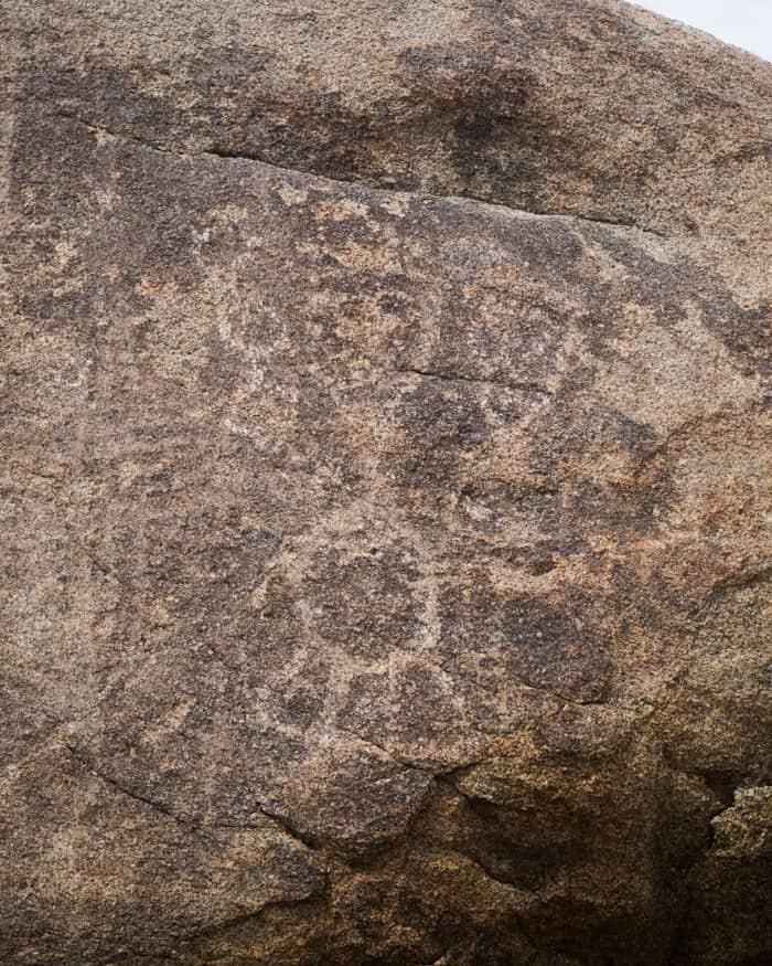 A close up of a rock with petroglyphs