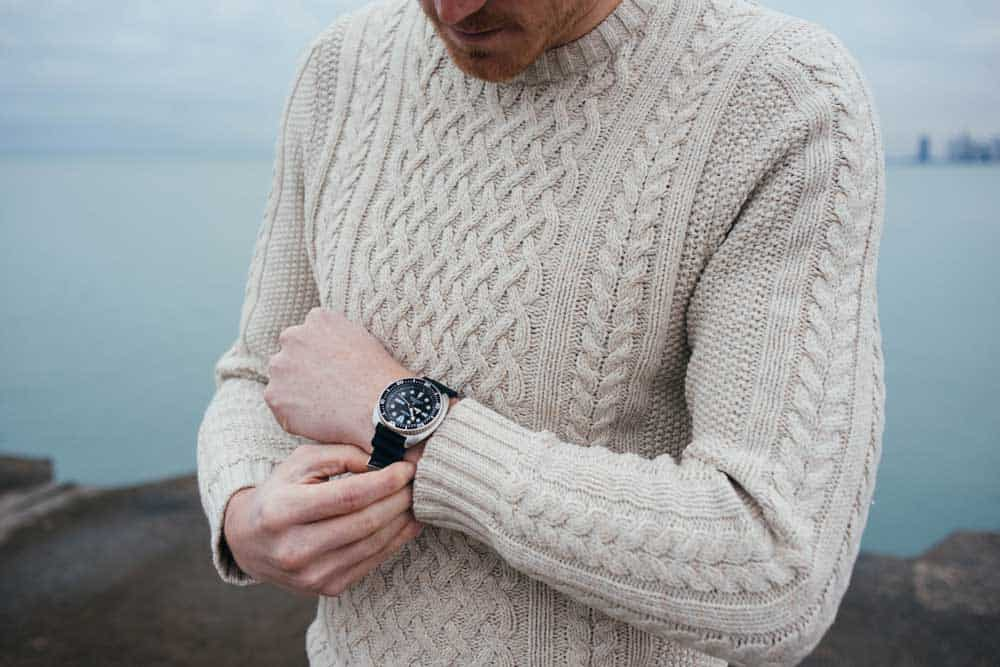Man in sweater with seiko watch