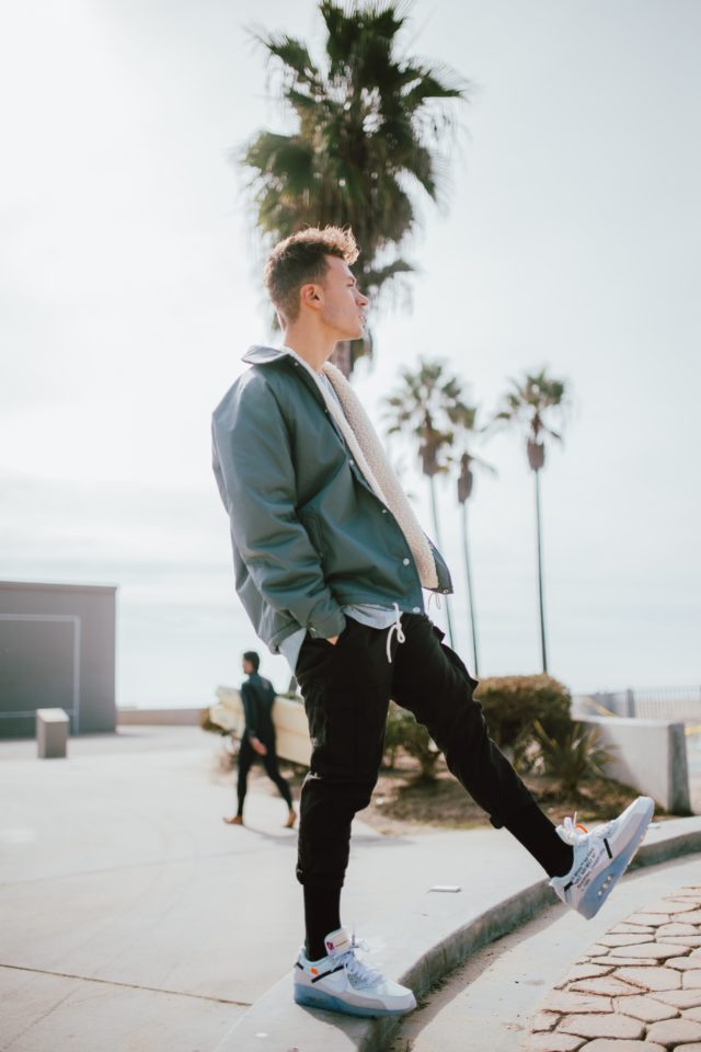 mens fashion silhouette - man on beach wearing baggy jacket with skinny pants