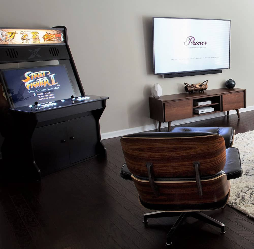 arcade in living room eames lounge chair mid century modern man living room apartment home