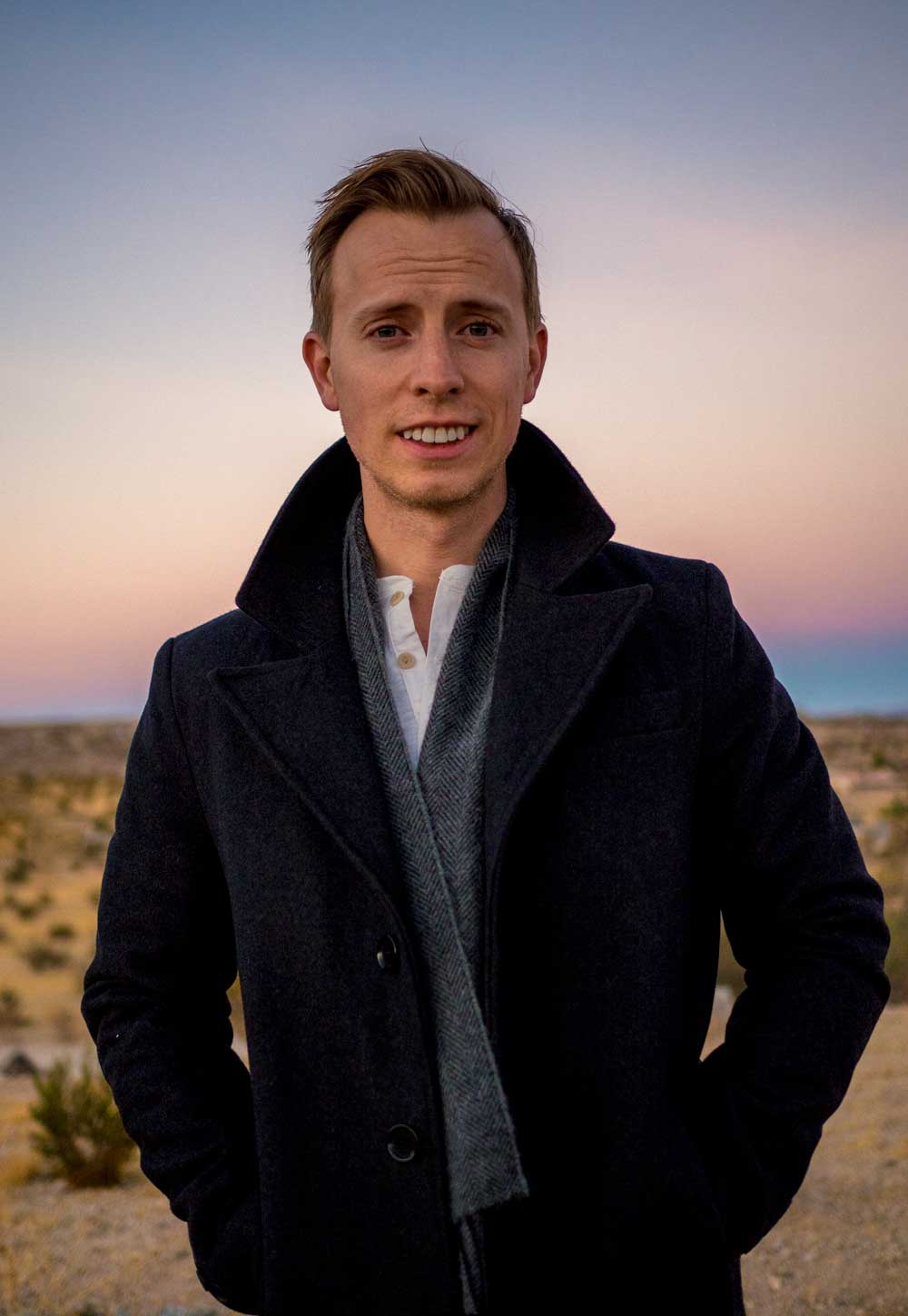 Photo of man wearing a layered outfit in Joshua Tree