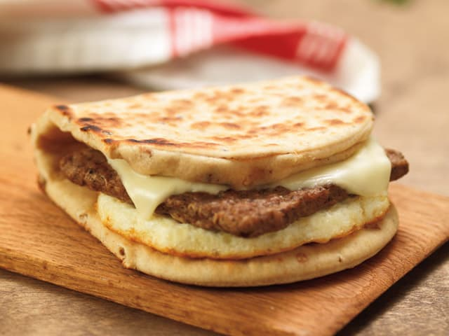 Image of dunkin donuts turkey sausage flatbread breakfast sandwich