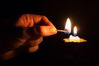 Hand lighting candles