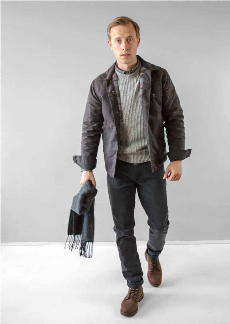 guy fashion brown trucker jacket gray sweater charcoal jeans gray scarf brown boots gray wall