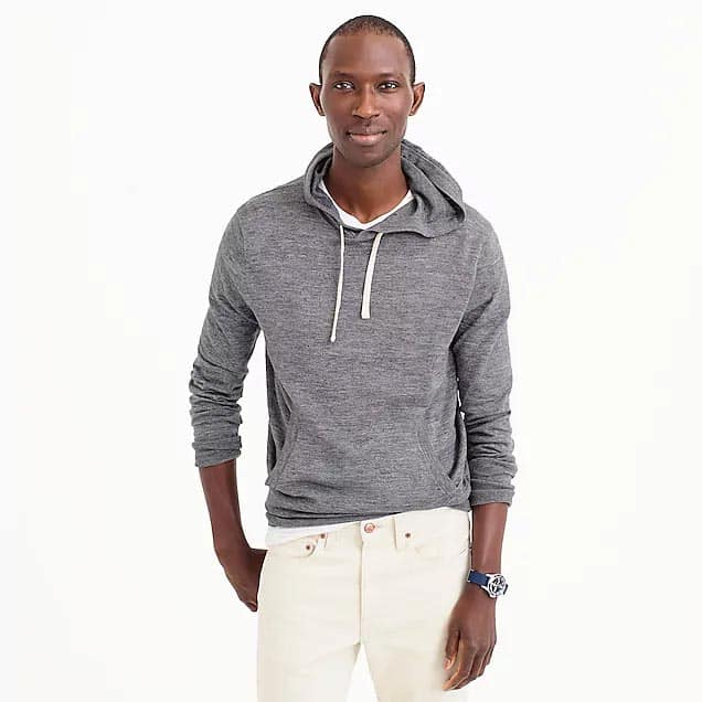 Armando Cabral standing posing for the camera wearing a gray hoodie