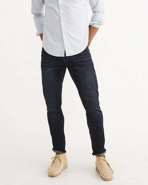 Dark blue jeans cuffed with boots