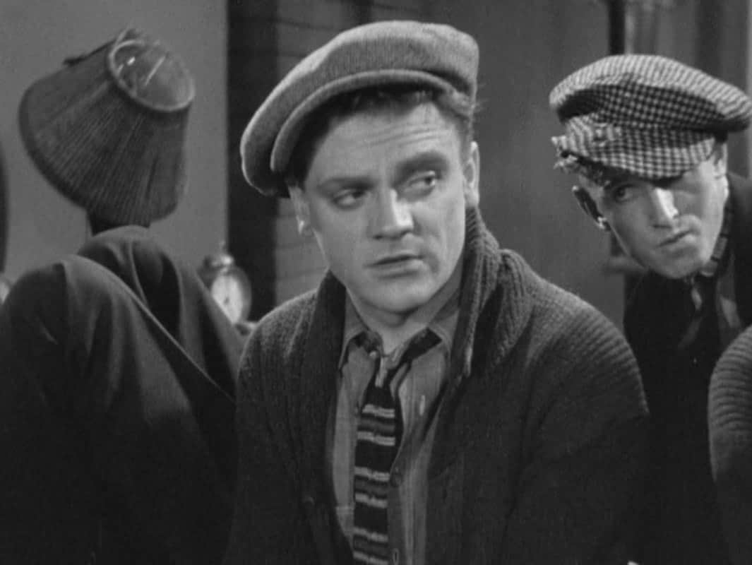 James Cagney wearing a hat and knit tie