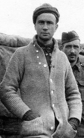 A vintage photo of a man wearing a sweater