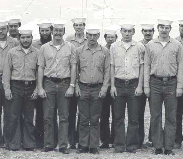 A group of sailors posing for a photo