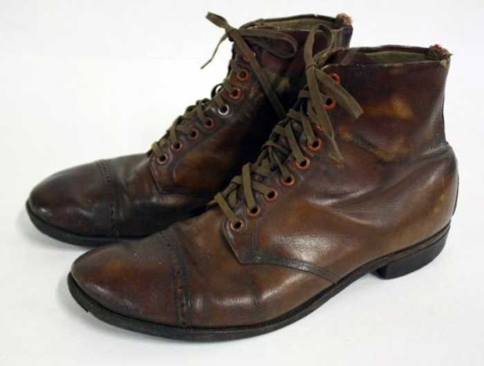 A pair of brown service boots