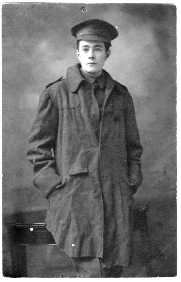 A vintage photo of a soldier wearing a trench coat