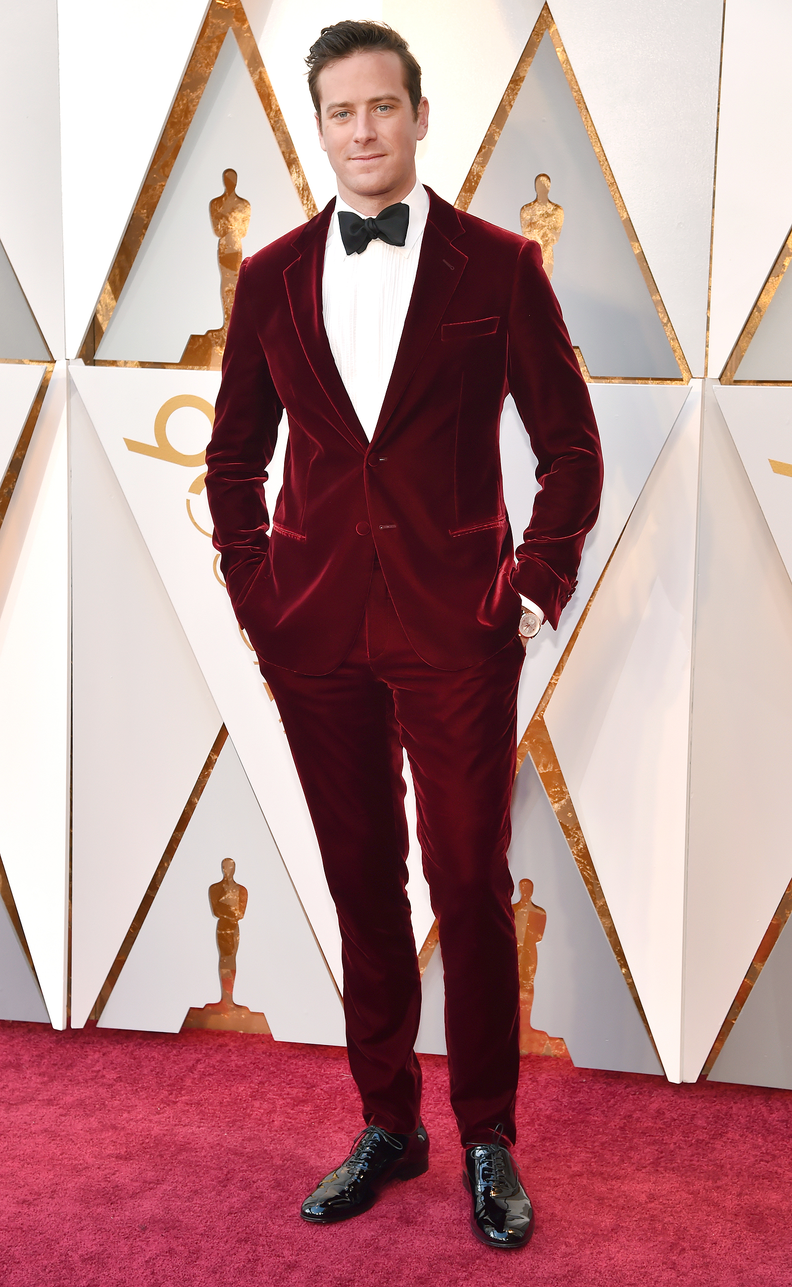 Image of Armie Hammer wearing burgundy tuxedo