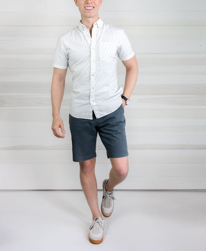 men's spring summer fashion white button up short sleeve shirt blue shorts above the knee
