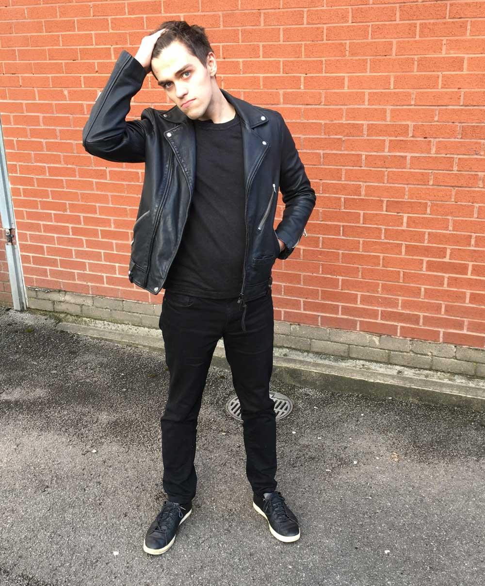 Zac Silk wearing a black outfit