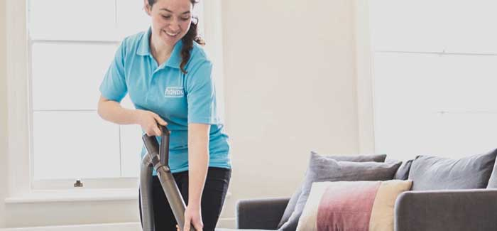 A woman vacuuming in a room