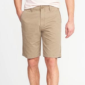 A person standing posing for the camera, with TAN Shorts