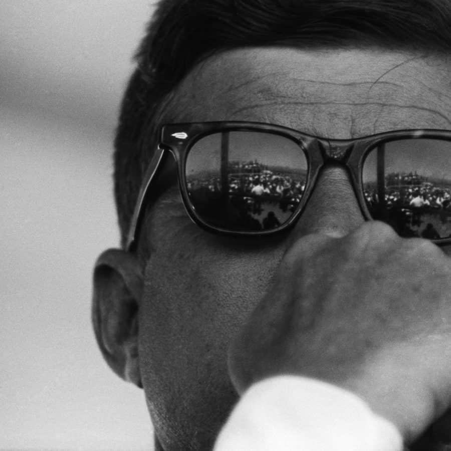 A close up of John F. Kennedy wearing sunglasses
