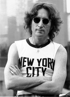 John Lennon posing for the camera