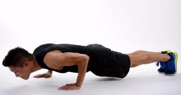 Image of man doing one half rep pushup exercise