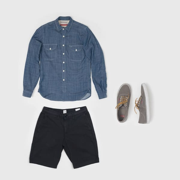men fashion flatlay chambray shirt black shorts gray vans