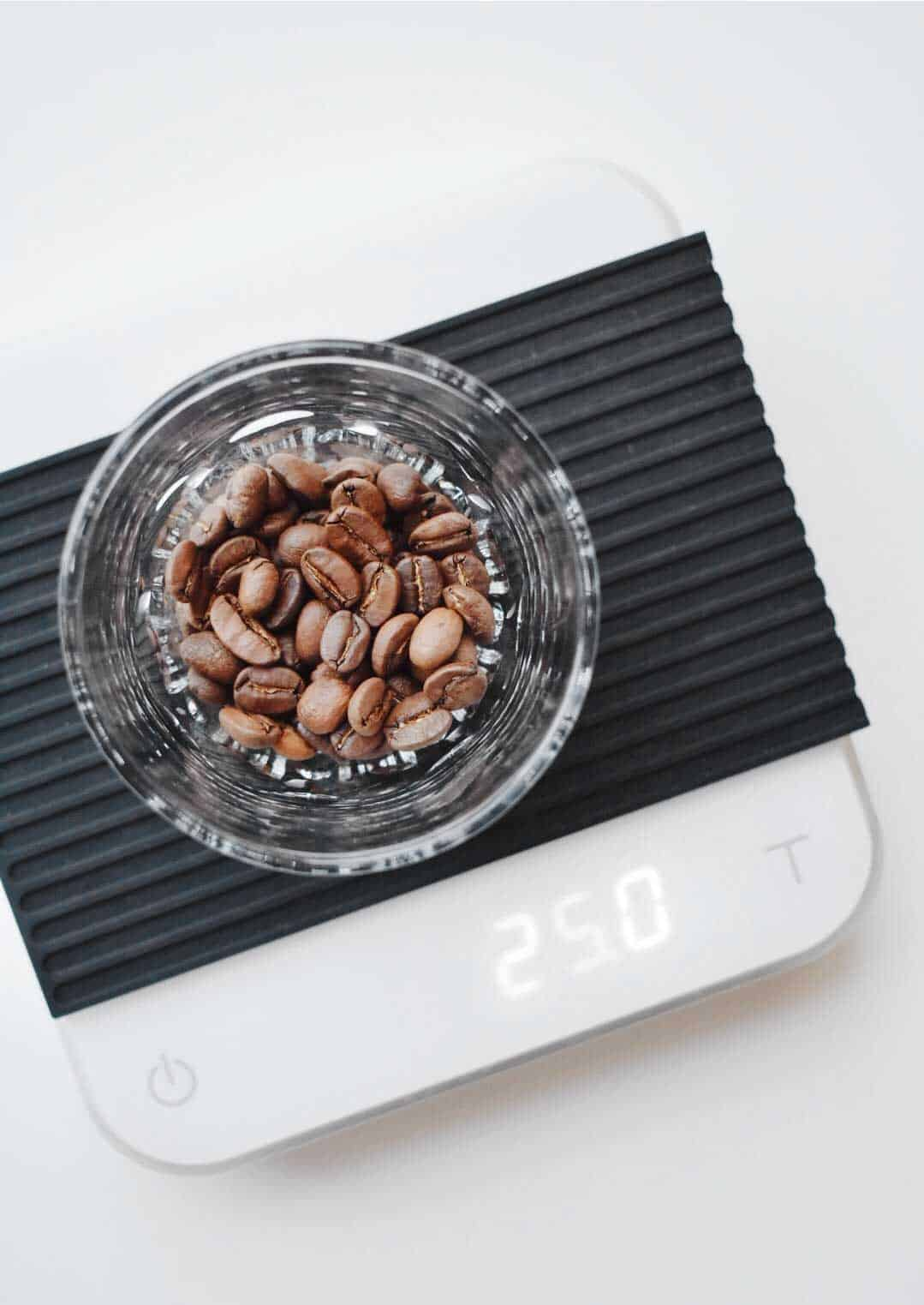 coffee beans on digital scale - coffee to water ratio