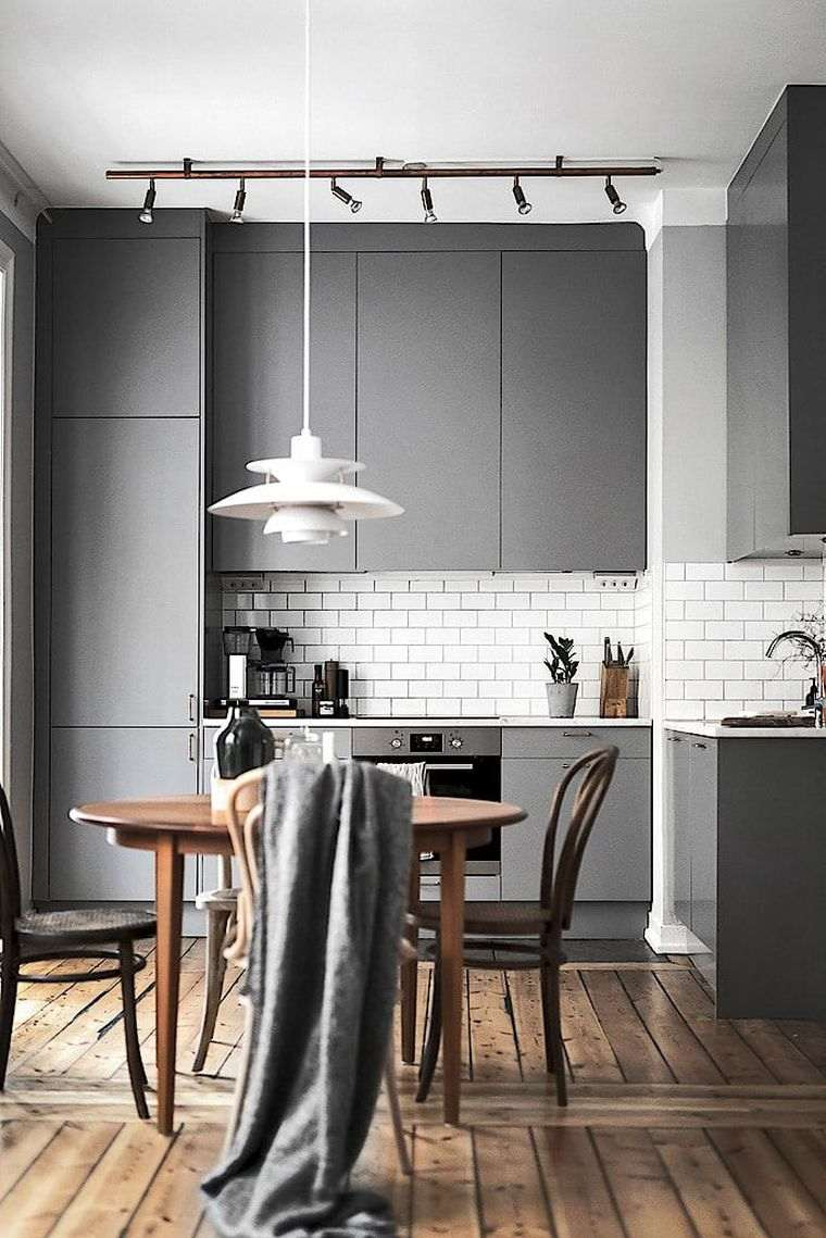 Image of Scandinavian designed kitchen with grey cupboards