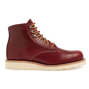 Brown leather boots with white sole