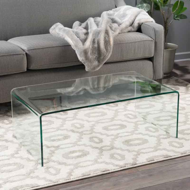 A living room with glass table