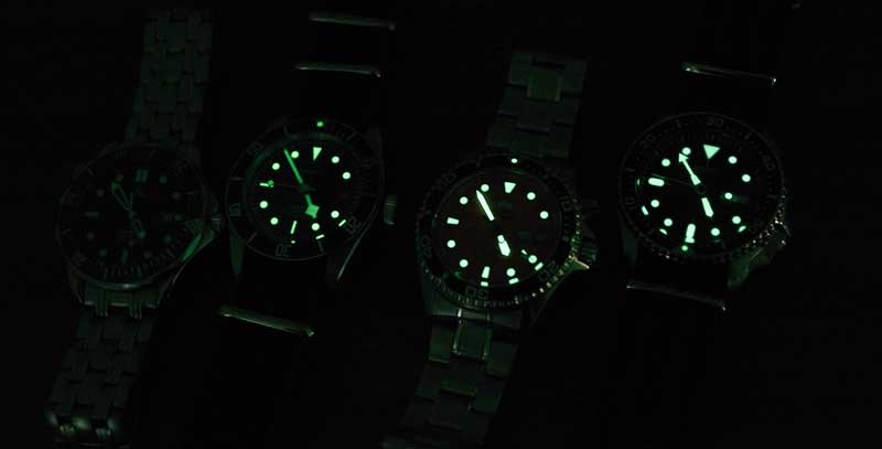 dive watch lume on 4 watches
