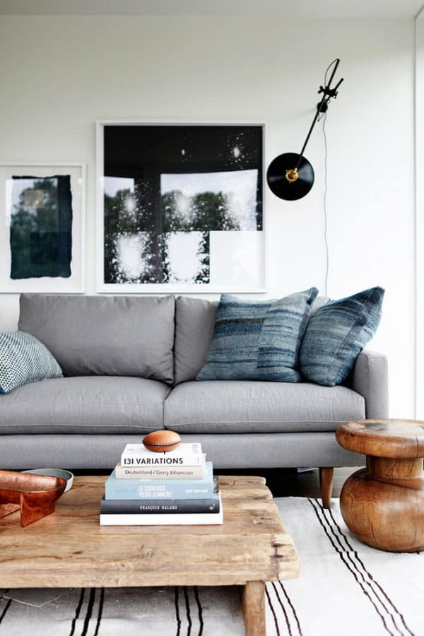 Image of grey couch and wooden end table
