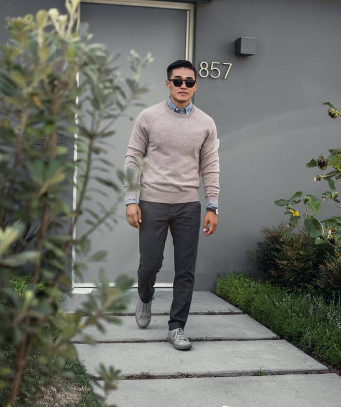 man wearing smart casual outfit with gray sneakers