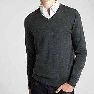 A man wearing v neck sweater