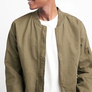 A man wearing a bomber jacket