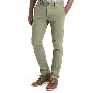 A person standing posing for the camera wearing green pants