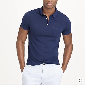 A person standing posing for the camera wearing a blue polo