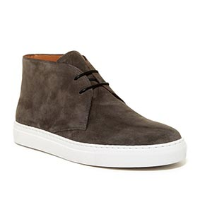 A close up of brown suede shoes