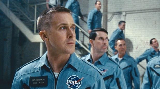 Ryan Gosling standing in front of astronauts