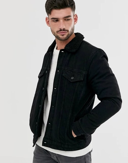 A person standing posing for the camera wearing a black asos denim jacket