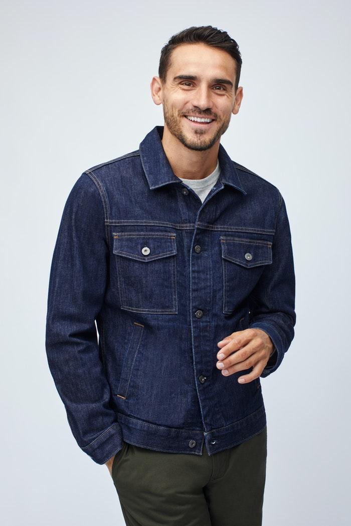 Man wearing a buttoned up denim jacket