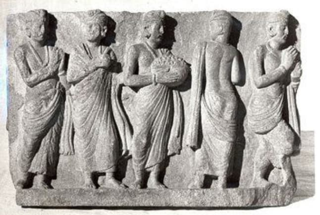 Ancient sculpture of people in robes