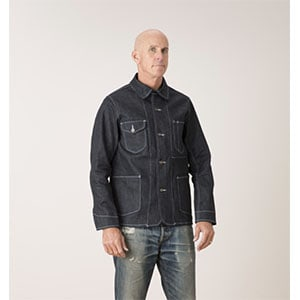 A person standing posing for the camera wearing a denim jacket that isn\'t a trucker jacket
