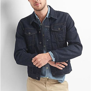 A person posing for the camera in a denim jacket