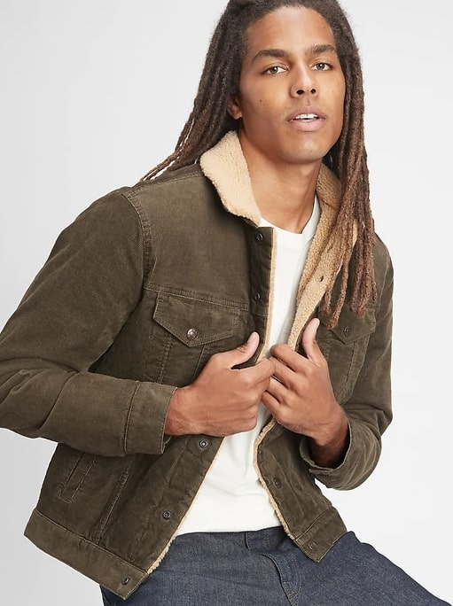 A person posing for the camera wearing a corduroy trucker jacket