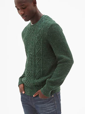 A person wearing a green sweater