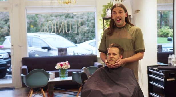 Jonathan van ness grooming a man in a chair