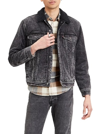 A person standing posing for the camera wearing levi\'s fleece denim jacket
