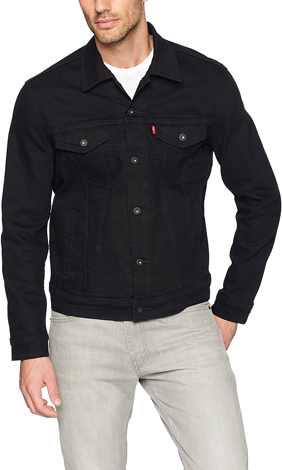A person standing posing for the camera weraing a black trucker jacket