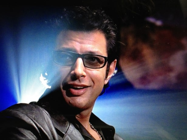 Jeff Goldblum wearing glasses,  as Ian Malcolm