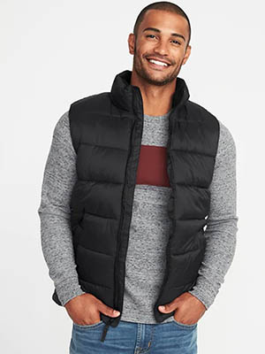A person posing for the camera, with Old Navy vest